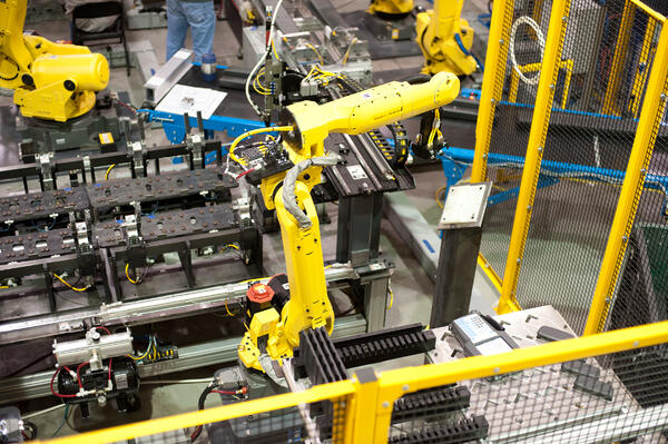 yellow car manufacturing robot