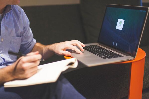 Man tracking his timesheet using software
